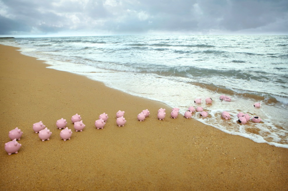 http://www.occupy.com/sites/default/files/field/image/piggy-bank-offshore-banking-beach.jpg