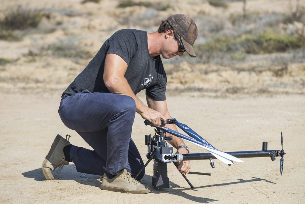 Scott Sanders, head of operations for Anduril Industries, prepares a Lattice Modular Heli-Drone for a test flight at the Red Beach training area, Marine Corps Base Camp Pendleton, Calif., on Nov. 8, 2018. Photo: Cpl. Dylan Chagnon/U.S. Marine Corps