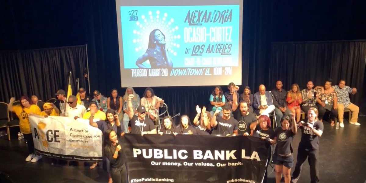 Public Bank LA on stage at an Alexandria Ocasio-Cortez event in downtown Los Angeles on August 2, 2018.