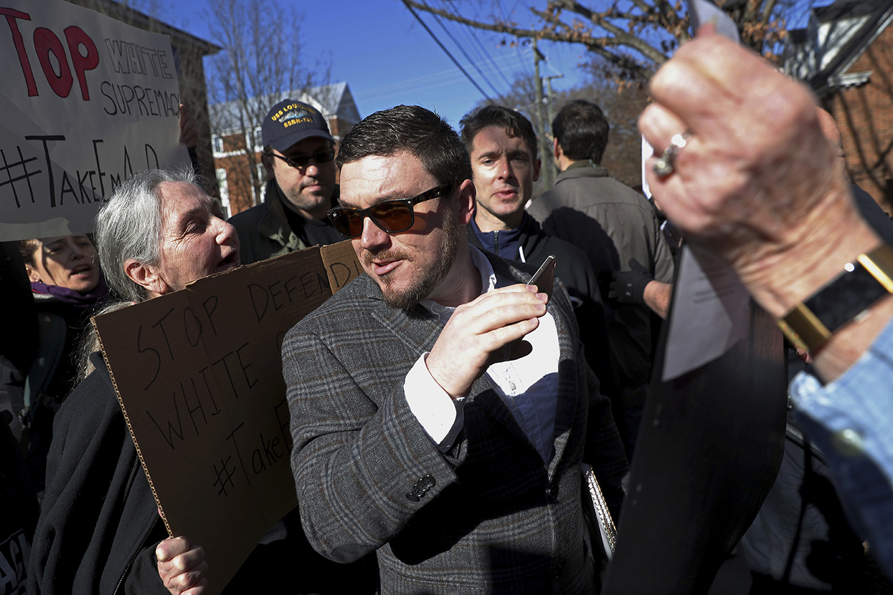 Jason Kessler walks through a crowd of protesters in front of the Charlottesville Circuit Courthouse on Feb. 27, 2018, ahead of a decision regarding the covered Confederate statues. Photo: Zack Wajsgras/The Daily Progress via AP