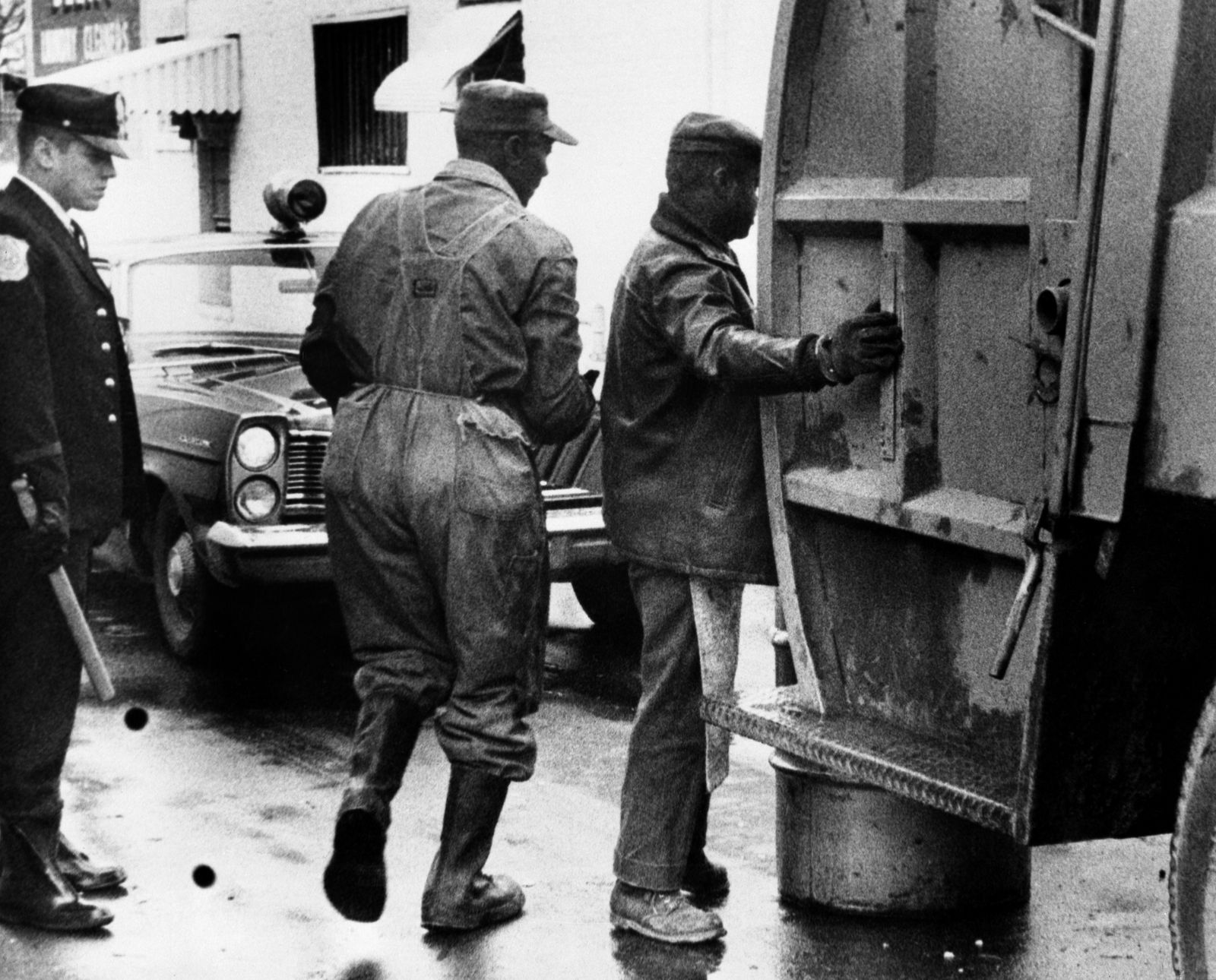 Two non-striking sanitation workers pick up trash in downtown Memphis. Bettmann Archive/Getty Images