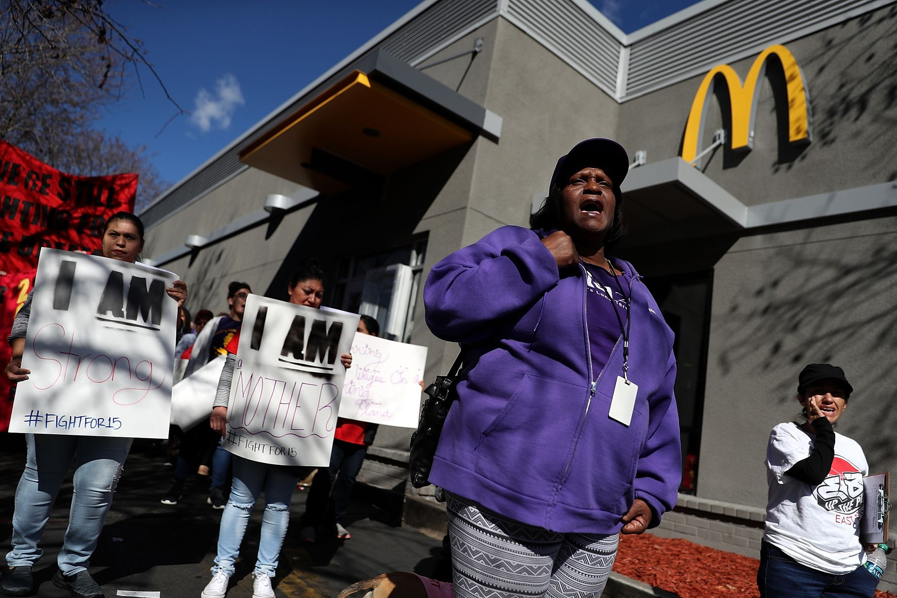 Fast-food workers and union members carry signs as they stage a protest outside of a McDonald's restaurant on February 12, 2018, in Oakland, California. Justin Sullivan/Getty Images