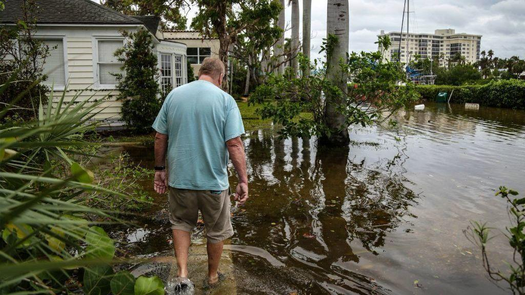 Warming ocean water contributes to sea level rise and can strengthen hurricanes. Hurricane Irma's storm surge last year was the latest to flood Jacksonville, Florida. Credit: Sean Rayford/Getty Images