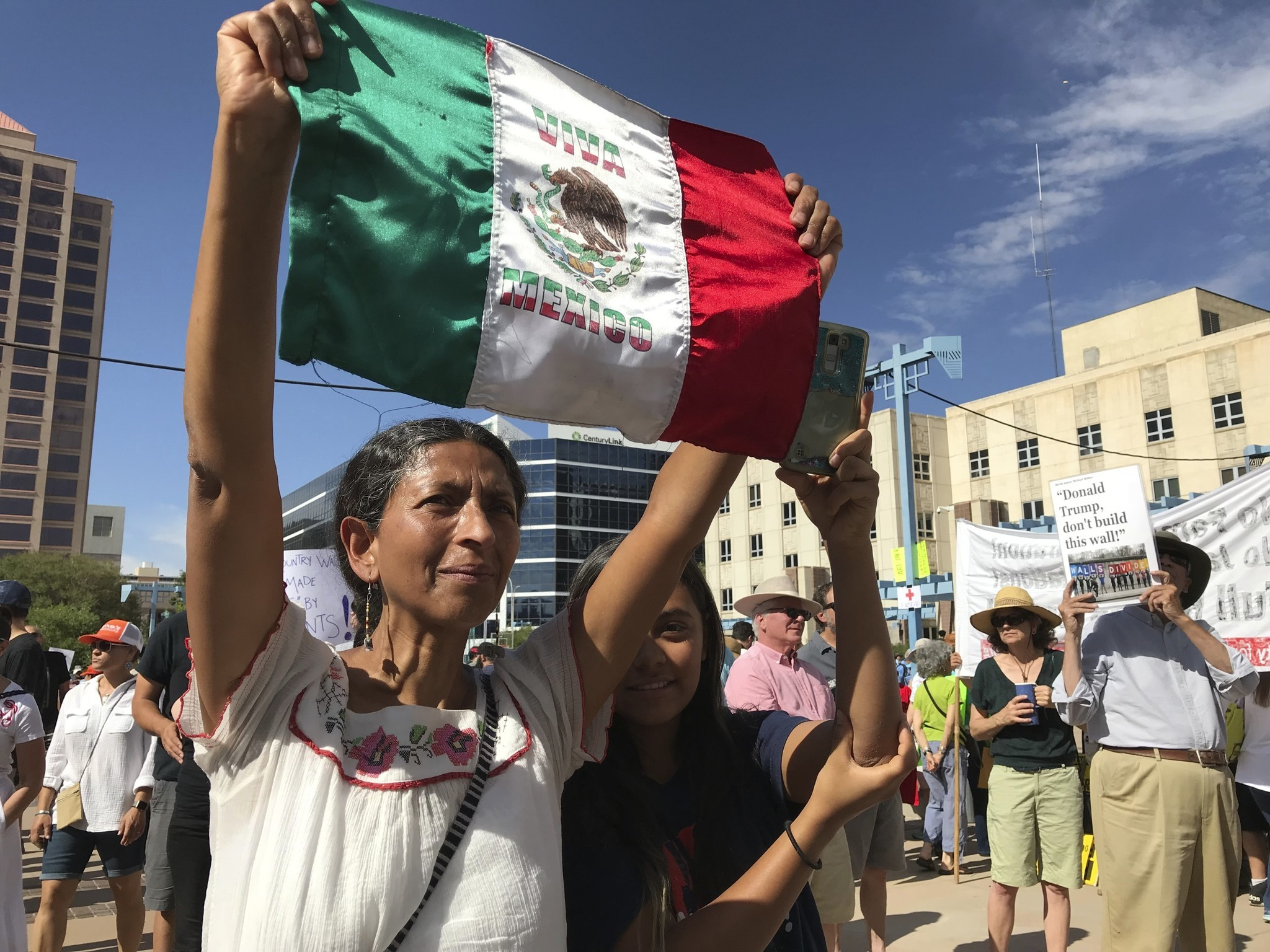 ALBUQUERQUE: Margarita Perez, with her daughter by her side, holds up a Mexican flag during a protest on Civic Plaza. Susan Montoya Bryan / Associated Press