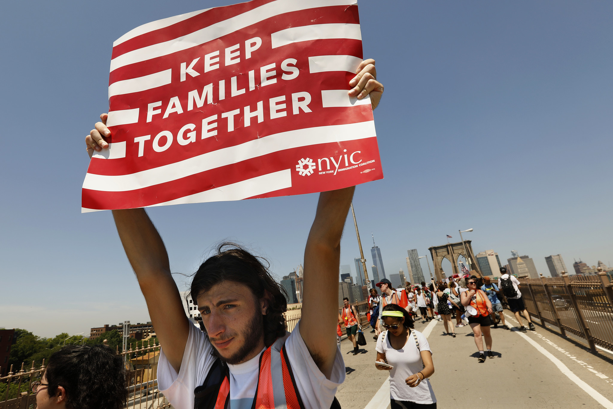"""NEW YORK: Ariel Schwartz, 19, of Long Island, takes part in a march to keep families together. """"I'm sick and tired of innocent families being treated like criminals,"""" Schwartz said. Carolyn Cole / Los Angeles Times"""