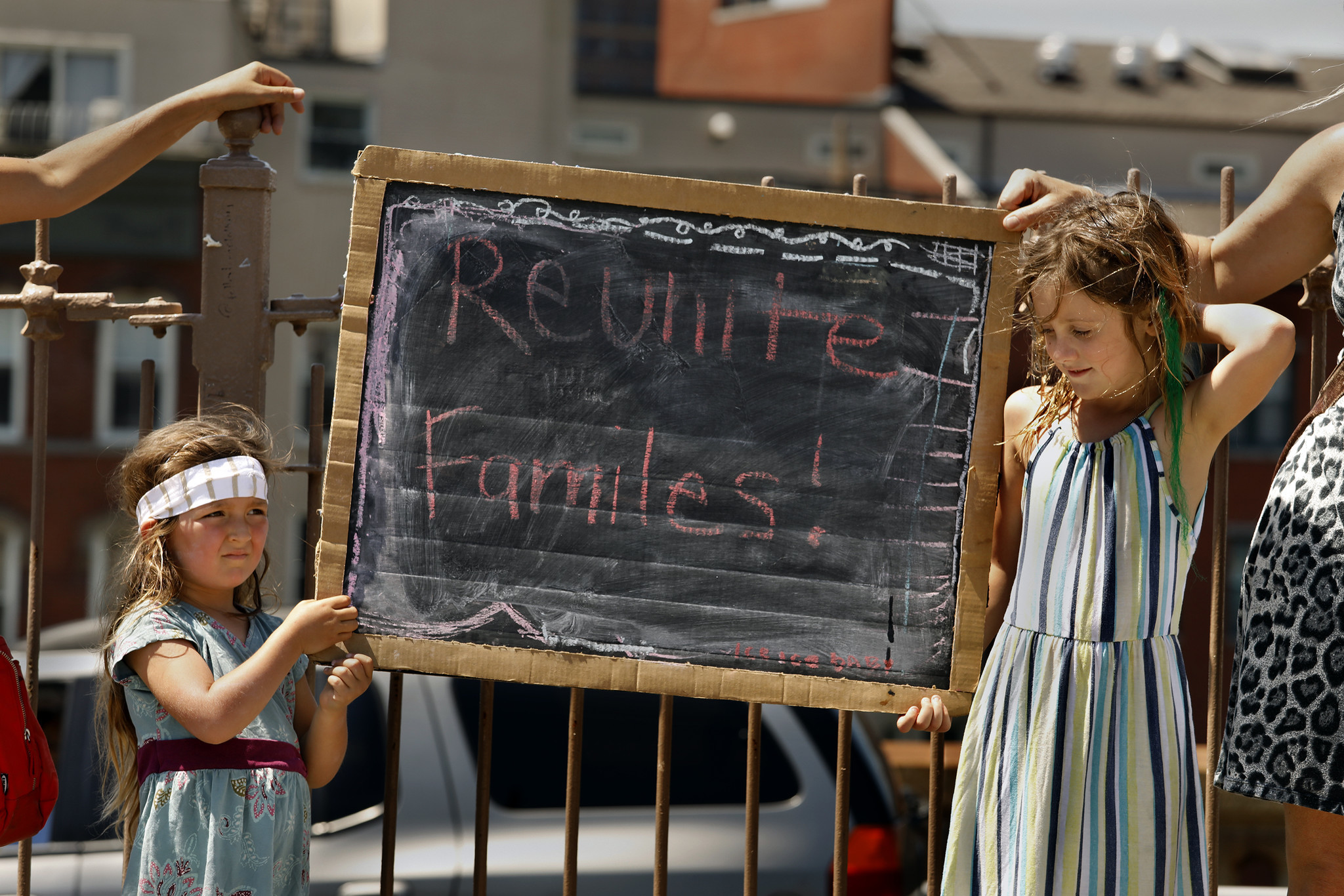 NEW YORK: Maite Temple-Dwyer, 3, and Zora Kane Tornquist, 7, hold a sign while marching with their mothers on the Brooklyn Bridge. Carolyn Cole / Los Angeles Times