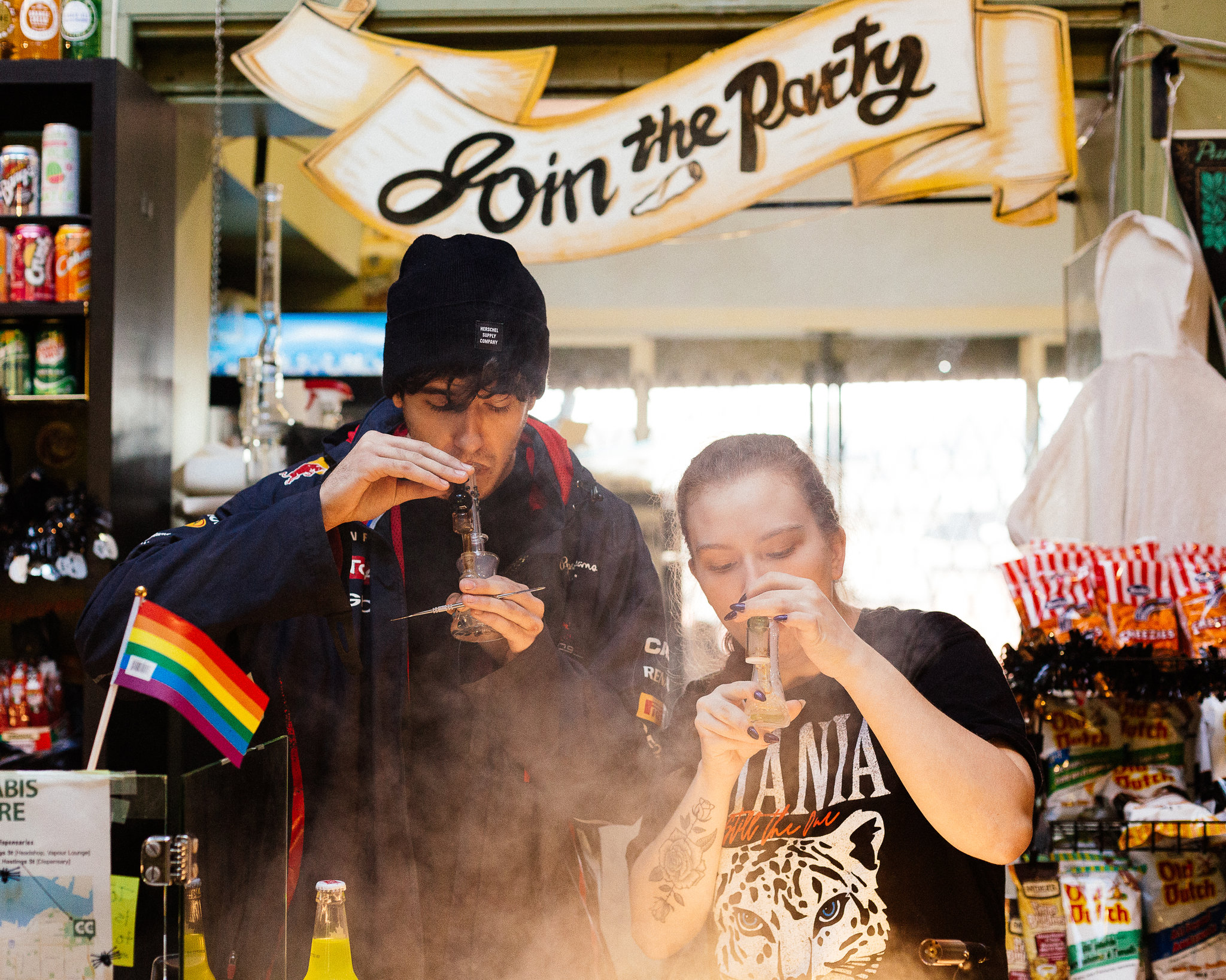 People smoking pot at a store in Vancouver, British Columbia. Licensed cannabis growers have been rushing for months to get a foothold in what is expected to be a $5 billion industry by 2020. Credit: Alana Paterson for The New York Times