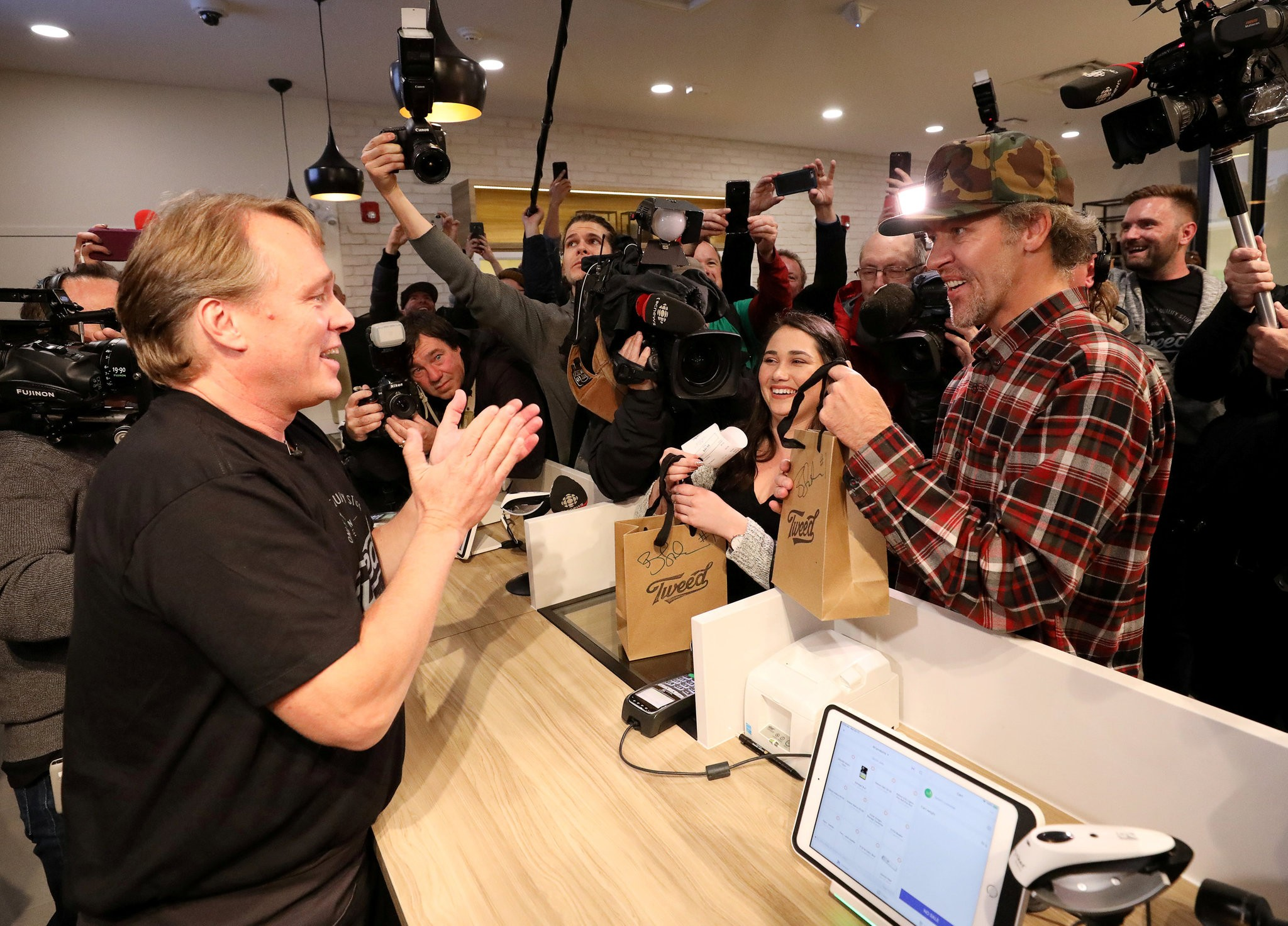 The first legal cannabis sale at Tweed, a retail store in St. John's. Canada is only the second country in the world, after Uruguay, to legalize cannabis. Credit: Chris Wattie/Reuters