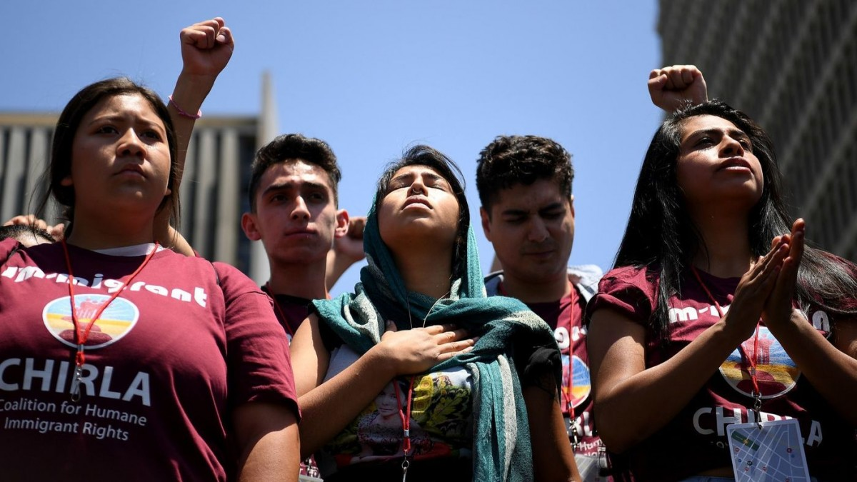 Protestors listen to speeches during a downtown L.A. rally against U.S. immigration policies. (Wally Skalij / Los Angeles Times)