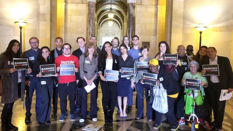 Grassroots organizers with Public Bank LA, Alliance of Californians for Community Empowerment, Democratic Socialists of America—Los Angeles, and the Bernie Sanders Brigade gather at City Hall in May 2018 for a Citizens' Lobby Day for Public Banking.