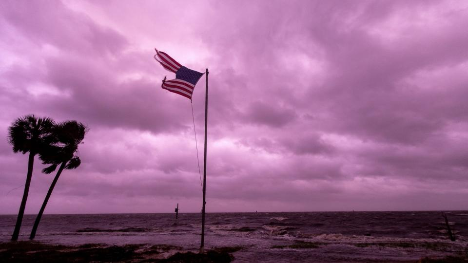 An American flag battered by Hurricane Michael continues to fly in the in the purple colored light of sunset at Shell Point Beach on October 10, 2018 in Crawfordville, Florida. Photograph: Mark Wallheiser/Getty Images