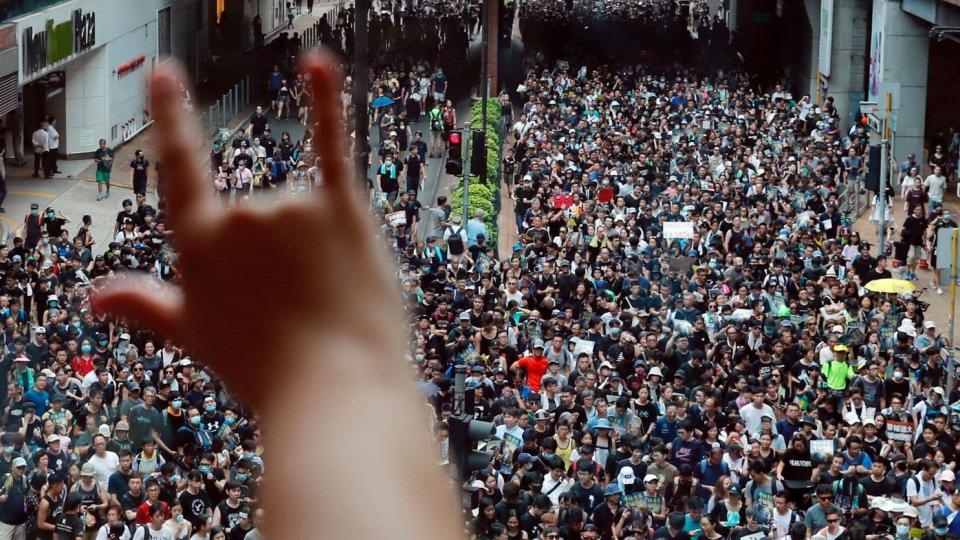 Demonstrators protesting an extradition bill march in the Sha Tin area of Hong Kong on Sunday. (Tyrone Siu/Reuters)