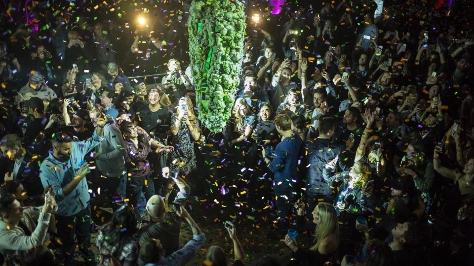 """People gathered in Toronto to watch the """"bud drop"""" at the stroke of midnight, in celebration of the legalization on Wednesday of recreational cannabis use in Canada.CreditIan Willms/Getty Images"""