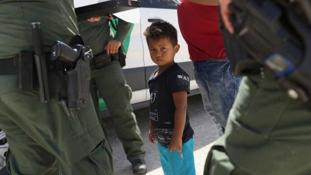 U.S. Border Patrol agents take into custody a father and son from Honduras near the U.S.-Mexico border on June 12, 2018, near Mission, Texas. The asylum seekers were then sent to a processing center for possible separation. Photo: John Moore/Getty Images