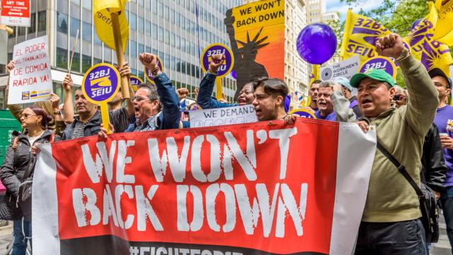 Fast-food workers, cashiers, cooks, delivery people and their supporters rally outside New York City Hall on May 24, 2017. Photo: Pacific Press/LightRocket via Getty Images