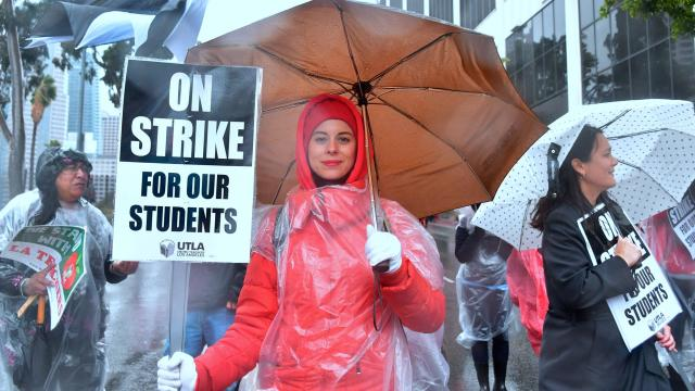 Yevgeniya Pokhilko, an elementary school teacher, holds a sign. Photograph: Frederic J Brown/AFP/Getty Images