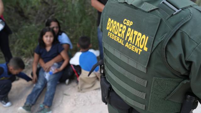 US Border Patrol agents take a family into custody near McAllen, Texas. Photograph: John Moore/Getty Images
