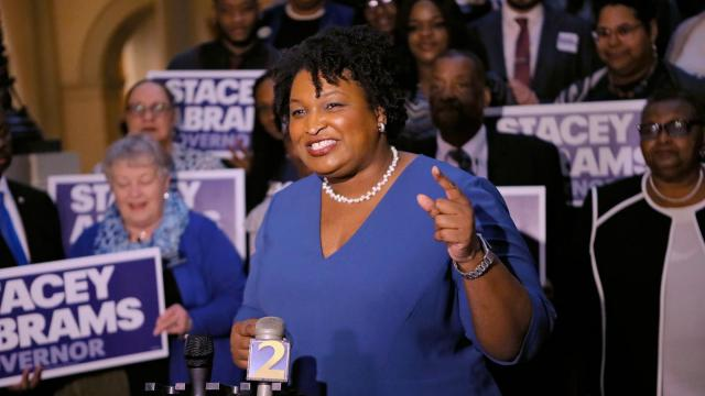 Stacey Abrams holds a news conference in Atlanta to announce she has qualified to run for governor. (Bob Andres / Atlanta Journal-Constitution via AP)